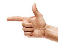Man`s hand points a finger at something isolated on white background. Stock Images