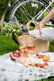 Man`s Hand Pouring Rose Wine Into Glasses, Summer Picnic Royalty Free Stock Images