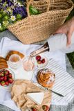 Man`s Hand Pouring Rose Wine Into Glasses, Summer Picnic Stock Photo