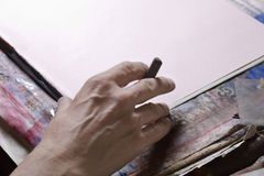 Man's Hand Preparing To Draw On Board Royalty Free Stock Photography