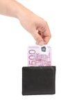 Man's hand pulling cash from the wallet. Royalty Free Stock Photo