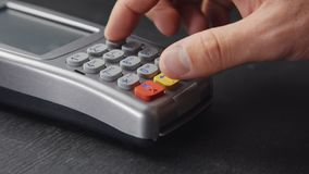 Person pushing the button on pos terminal stock footage