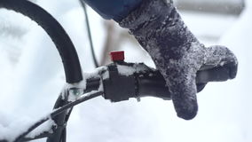 Man`s hand pushing the lever on a snowmobile stock video