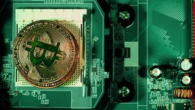 The man`s hand puts the bitcoins in a column. Hand counting bitcoins on the motherboard. Crypto currency Gold Bitcoin -. BTC - Bit Coin stock video footage