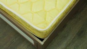 Man`s hand puts a mattress on bed. A man`s hand puts a mattress on the bed stock footage