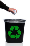 Man's Hand Putting Trash in Recycle Can. Man's hand placing paper in trash can with recycle symbol Stock Image
