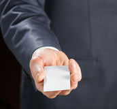 Man's hand reaches out blank badge Stock Images