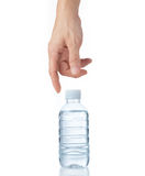 Man's hand reaching for a bottle of water. Man's hand reaching down for a clean and clear bottle of water,  white background Royalty Free Stock Image
