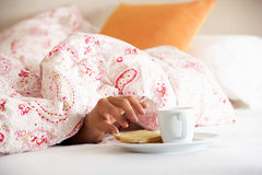 Man's Hand Reaching From Under Duvet For Breakfast Stock Photos