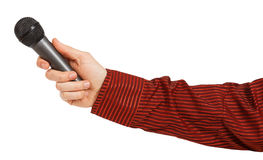 Man's hand in a red striped shirt holding a microphone Stock Photography