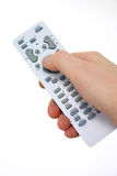 Man's hand on a remote control Stock Image
