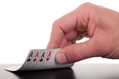 Man's hand revealing four aces Royalty Free Stock Image