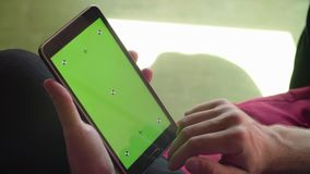 Man`s hand scrolling a tablet with green screen stock footage