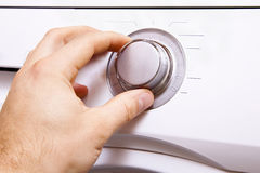 Man`s hand sets the parameters of the control button.5. Man`s hand sets the parameters of the control button Stock Photo