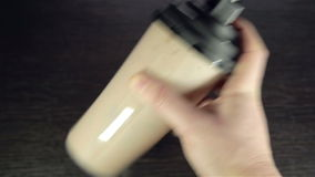 Man's hand shaking whey protein stock footage