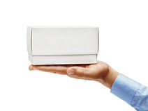 Man`s hand in a shirt holding white box isolated on white background. Close up. High resolution Stock Photos