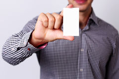 Man's hand showing business card Stock Photography