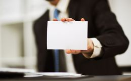 Man's hand showing business card Stock Photos