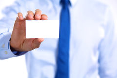 Man's hand showing business card - closeup shot on grey background Stock Photography
