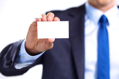 Man's hand showing business card - closeup shot on grey background Stock Photos
