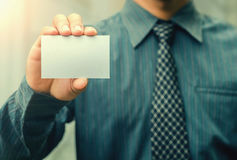 Man`s hand showing business card Stock Photos