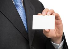 Man`s hand showing business card - closeup shot on white background.  Stock Photos