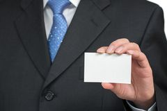 Man`s hand showing business card - closeup shot on white background.  Royalty Free Stock Photo