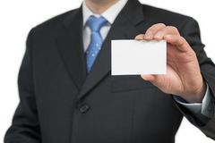 Man`s hand showing business card - closeup shot on white background.  Stock Images
