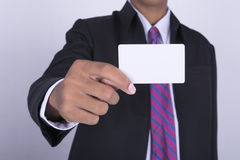 Man's hand showing business card select focus Stock Photo