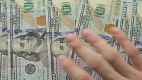Man`s hand shows new us dollar banknotes on white background. Person gives Deposit or credit. Happy male wins in lottery cash in bucks stock video footage