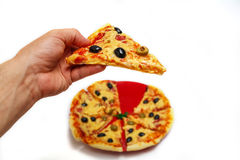 A man`s hand with a slice of pizza. royalty free stock images