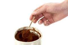 The man's hand with spoon takes coffee Royalty Free Stock Photo