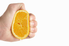 Man's hand squeezing Orange Royalty Free Stock Photo