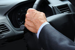 Man's Hand on Steering Wheel Stock Photo