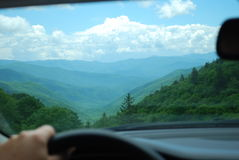 Man`s hand on steering wheel and mountain view royalty free stock photo