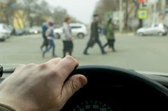 Man`s hand on the steering wheel royalty free stock photography