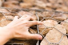 Man`s hand on a stone wall Stock Images