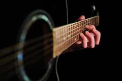 Man's hand striking a chord Royalty Free Stock Image