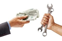 Man`s hand in suit giving cash money and man`s hand holding a spanners isolated on white background. Business concept. Close up. High resolution product royalty free stock photos