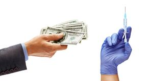 Man`s hand in suit holding cash money and man`s hand in medical glove with syringe. Isolated on white background. Medical and business concept. Close up. High stock photos