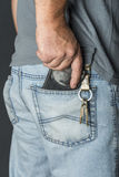 Man`s hand taking wallet Stock Photography