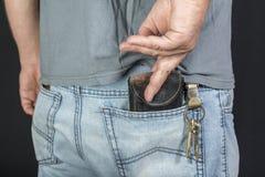 Man`s hand taking wallet Stock Photos