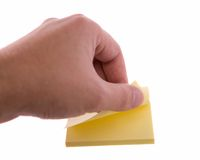 Man's hand tearing a sticker. Royalty Free Stock Photos