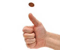 Man's hand throwing up a coin to make a decision. On white stock photography