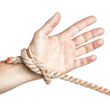 Man's hand tied  limitation with a rope. On a white background Royalty Free Stock Images