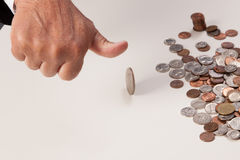 Man's hand tossing coin closeup thumb up Royalty Free Stock Photo