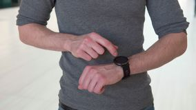 Hand touches smart watch stock video footage