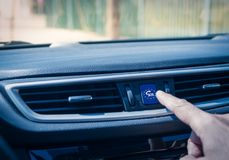 Man`s hand touching an ecall button. Car equiped with an eCall system. European initiative intended to bring rapid assistance to motorists involved in a royalty free stock photo