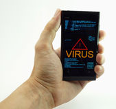 Man's hand touching smart phone with virus Royalty Free Stock Image