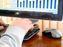 Man's hand typing at a computer keyboard. Stock Photo